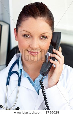 Portrait Of An Assertive Female Doctor Phoning In Her Office