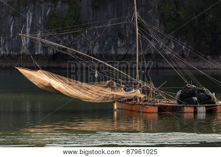 Floating squid fishing net on a large raft in Halong bay, Vietnam