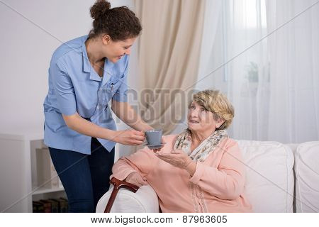 Caregiver Caring About Elder Lady