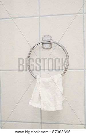 Clean little white towel on a hanger