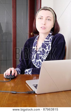 Women with a laptop at home