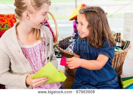 Kids buying supplies  in handicraft store