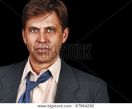 Portrait of straight forward business man on Blue