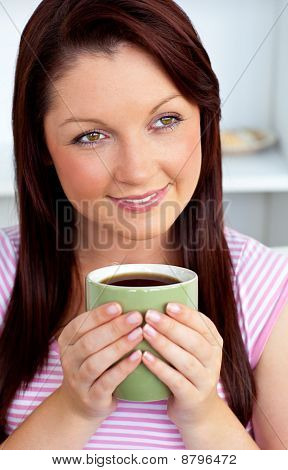 Positive Woman Holding A Cup Of Coffee