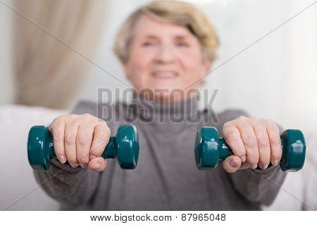 Elder Lady Training With Dumbbells