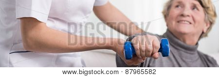 Elder Woman Training With Dumbbell
