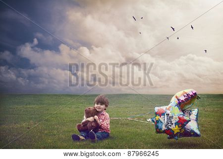 Small boy celebrating his birthday alone on empty field.