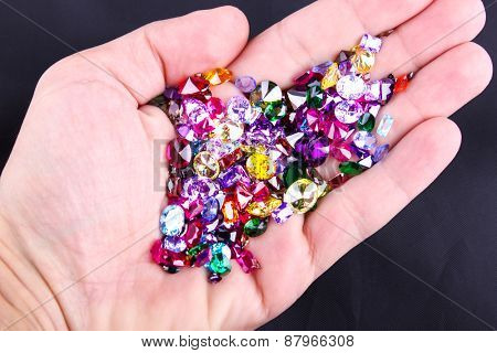 Many different natural gemstones in hand