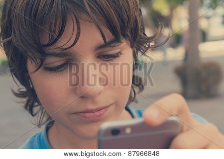 Boy With Smartphone On Street