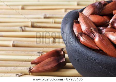 Pinhao - Brazilian Pine In Black Pot On Bamboo Table