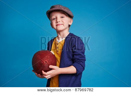 Cute boy with rugby ball