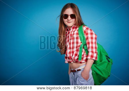 Cute schoolgirl in casualwear and sunglasses