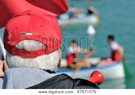 Referee Canoe Race With Red Cap