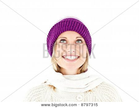 Bright Woman With A Colorful Hat And A Pullover Looking Upwards