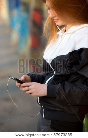Sporty Girl With Smartphone, Close-up
