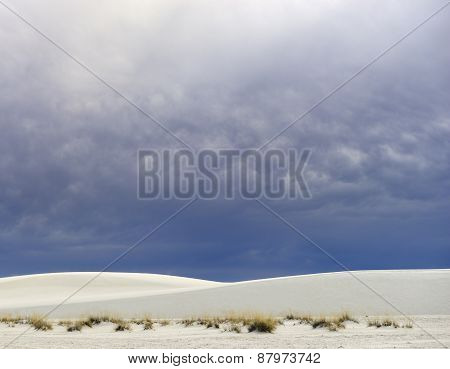Rolling White Sand Dunes and Dramatic Clouds