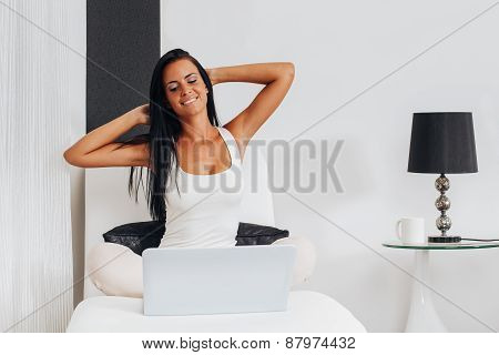 Beautiful Woman Sitting On Armchair With Laptop