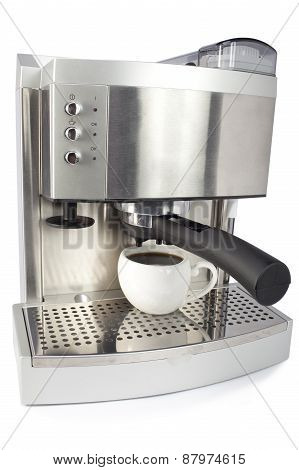 coffee maker and cup . Close up on a white background