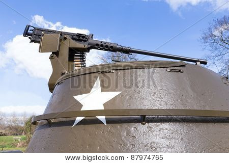 Machine gun on old american military tank with blue sky