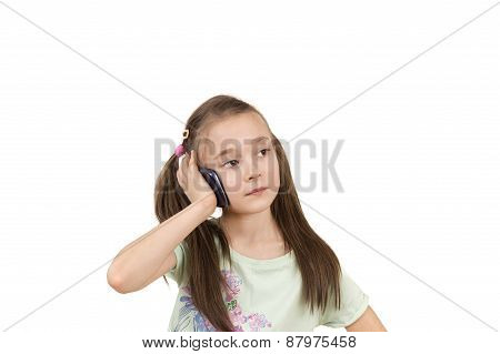 Portrait Of A Young Pig-tailed Girl Using Mobile Phone Isolated Over White