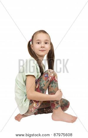 Portrait Of A Posing Young Pig-tailed Girl Isolated Over White
