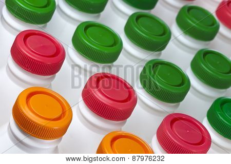 dairy products bottles with bright covers . Close up