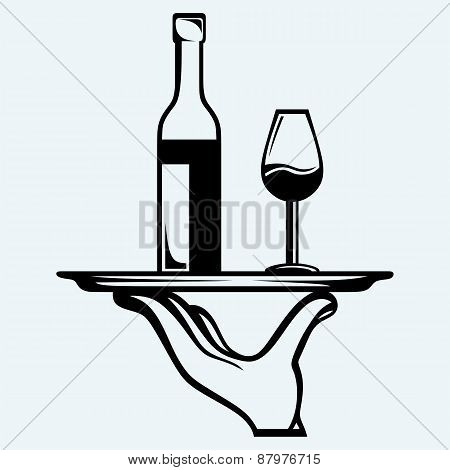 Bottle of wine with a glass on a tray