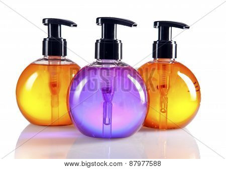 different color cosmetic bottles .Still-life on a white background