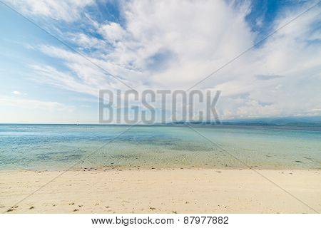 Empty Beach, Open Sea And Clouds