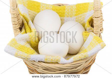Eggs On Napkin In Wooden Wicker Basket