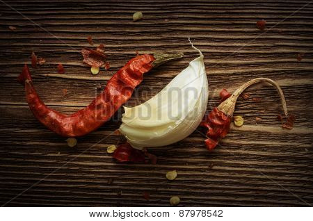 dried red chilli pepper on wood background