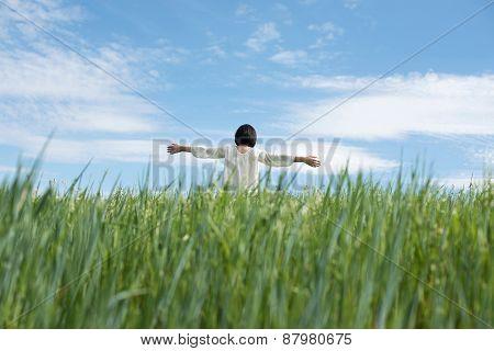 Woman In Green Field