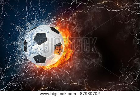 Soccer ball on fire and water with lightening around on black background. Horizontal layout with text space.