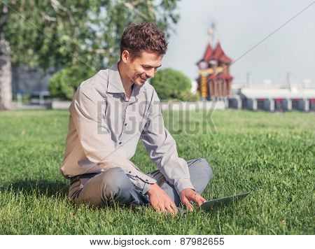 Young Man Work With Laptop In The City Park