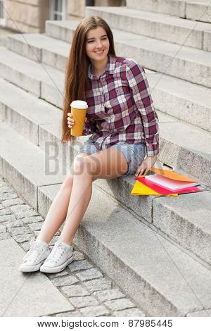 Student having a coffee break in the campus