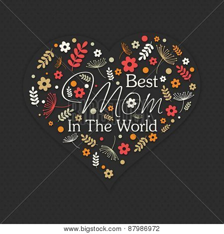 Beautiful flowers decorated heart with text Best Mom in the World on black background for Happy Mother's Day celebration.