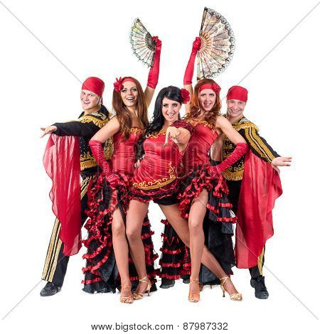 dancer team wearing in traditional flamenco dresses