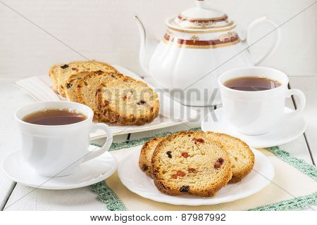Cake With Raisins, And Two Cups Of Tea