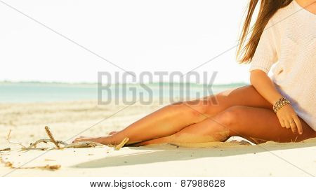 Girl Sunbathing Tanning On The Beach.