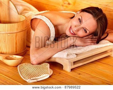 Young woman relaxing in sauna. Healthy lifestyle.