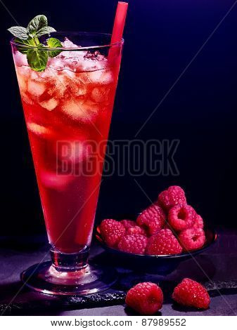 Red raspberry drink  with ice cube on black background. Cocktail card