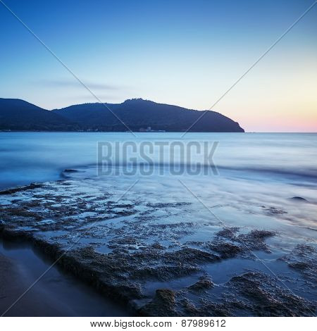 Baratti Bay, Headland Hill, Rocks And Sea On Sunset. Tuscany, Italy.