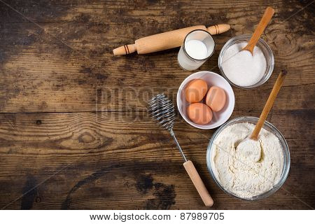 baking ingredients on brown wooden table