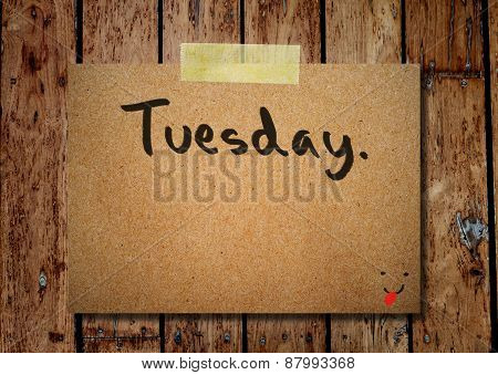 Tuesday On Note Paper With Wooden Background