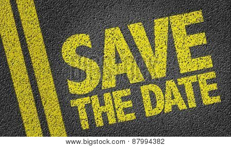 Save the Date written on the road