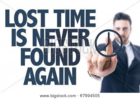 Business man pointing the text: Lost Time Is Never Found Again