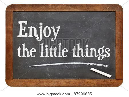 Enjoy little things - inspirational words on a vintage slate blackboard