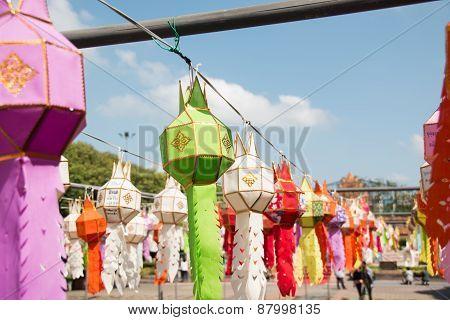 Thai lanterns hanging in street at night