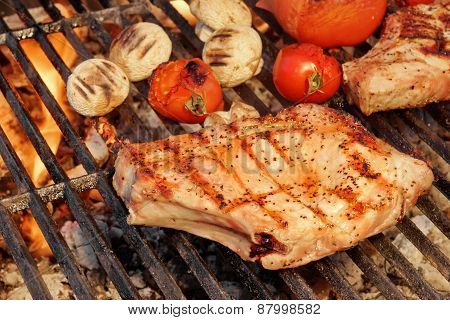 Barbeque Roasted Rib Steak, Tomatoes And Mushrooms On Hot Grill