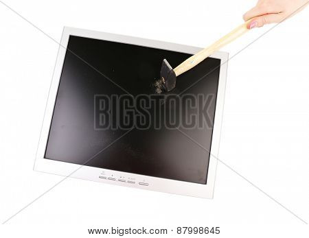 Old computer screen smashed with hummer isolated on white